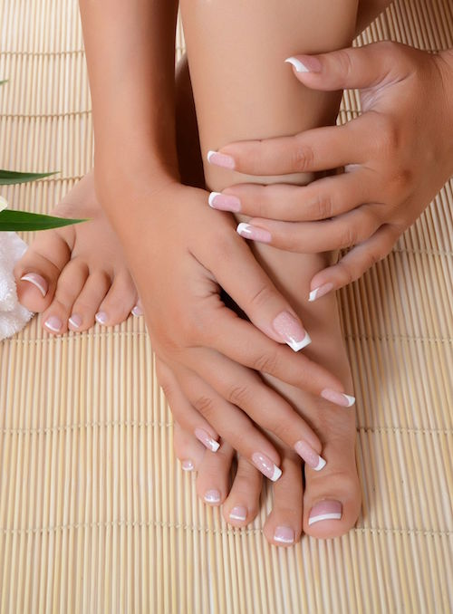 15798462 Woman Hand And Feet With Manicure And Lily